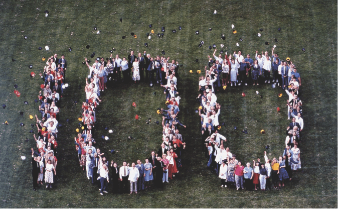 "Hormel employees spelling out ""100"""
