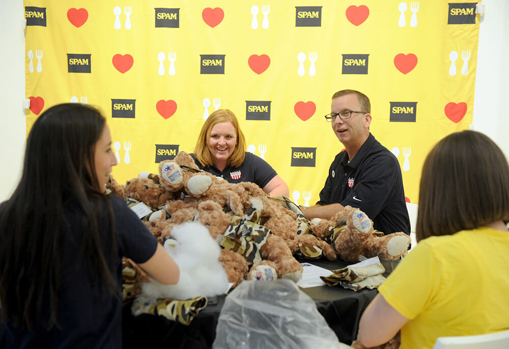 Jeff Baker, right, a U.S. Air Force veteran and Hormel Foods Group Vice President, joins other volunteers to kick-off the SPAMERICAN National Food Truck Tour and Operation Gratitude Partnership by assembling care packages, stuffing Battalion Buddies and writing letters, Monday, April 18, 2016 in New York. The SPAM brand is taking their gratitude on the road with the return of the popular SPAMERICAN Tour, thanking all of the chefs, fans and military for 79 years of support. (Photo by Diane Bondareff/AP Images for Hormel Foods)