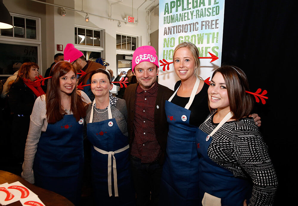 """PARK CITY, UT - JANUARY 22: Actor Elijah Wood (C) attends Applegate's """"Reel Food"""" Cafe featuring Wholly Guacamole during the 2016 Sundance Film Festival at The Village at the Lift on January 22, 2016 in Park City, Utah. (Photo by Rick Kern/Getty Images for Applegate) *** Local Caption *** Elijah Wood"""