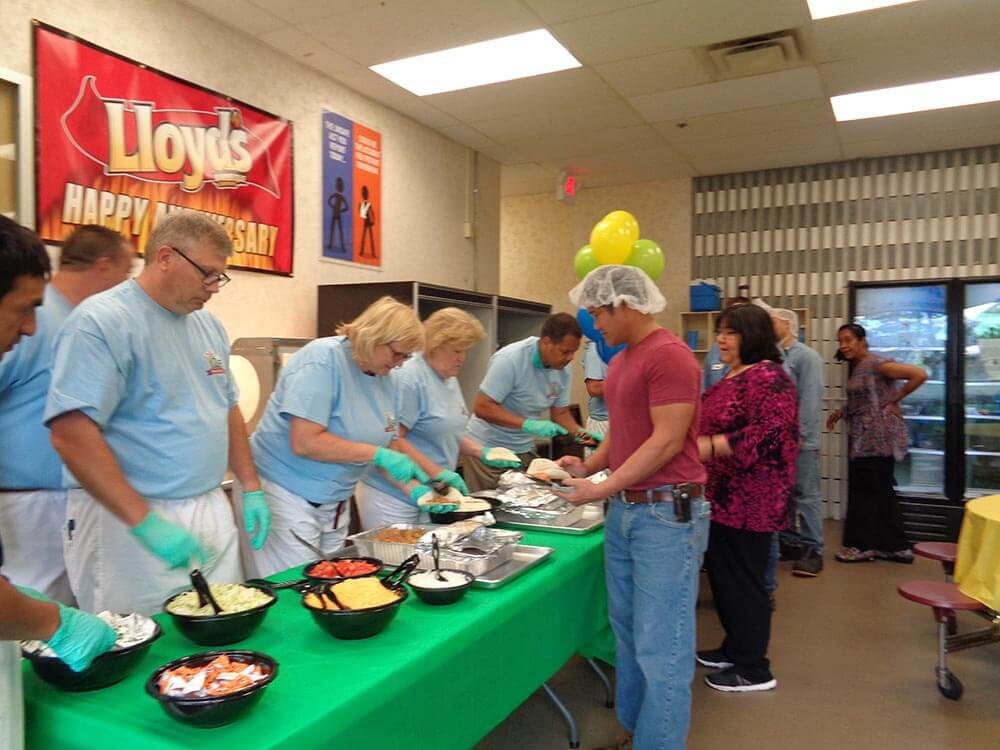 Management team serving catered lunch